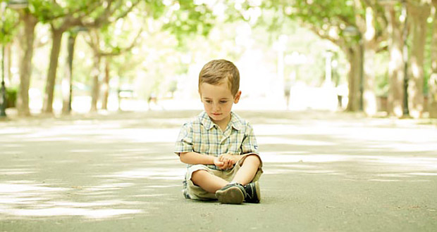 little boy sitting down
