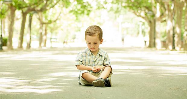 little boy sitting down