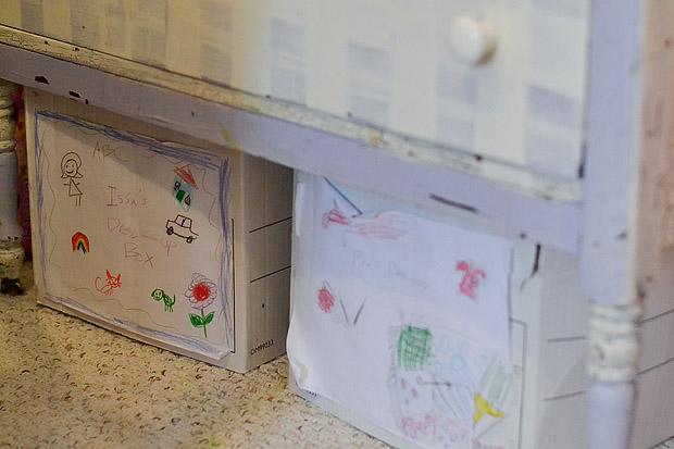 Boxes below dresser