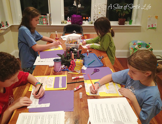 The Smith kids making a lapbook during school