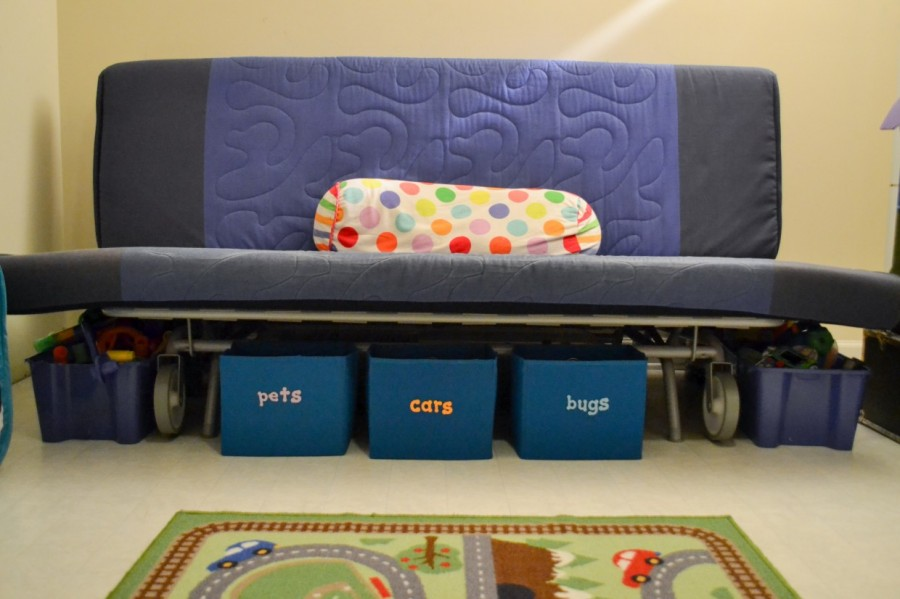 BLUE FUTON WITH BLUE LABELED BINS