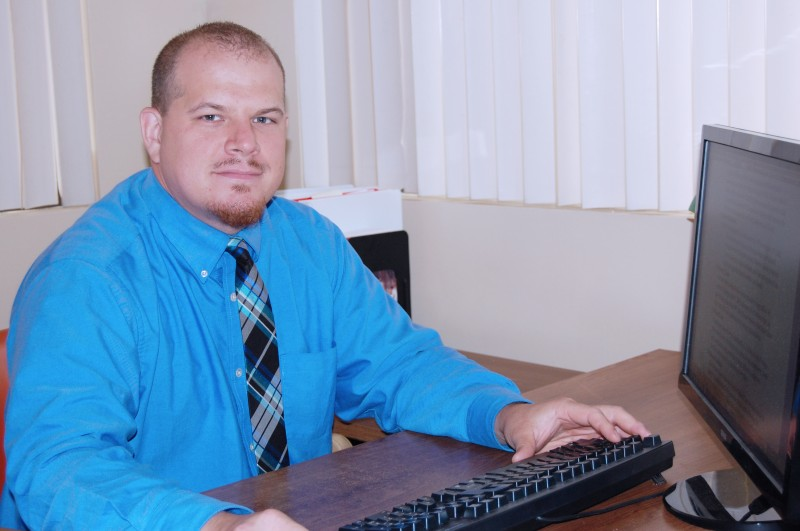 Mr. Nick Marmalejo responds to student questions and grades electronically-submitted student papers and assignments.