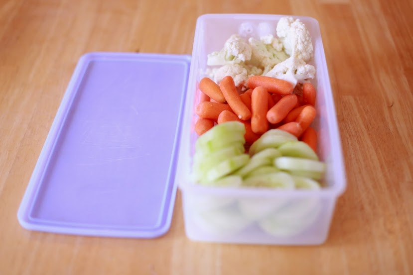 8 Simple Ways To Add More Fruits and Veggies To Your Family's Diet - by Abby Sasscer | Veggies in a Tupperware